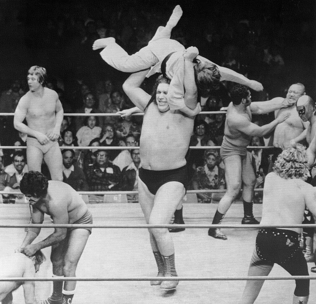 andre throwing a wrestler in the ring