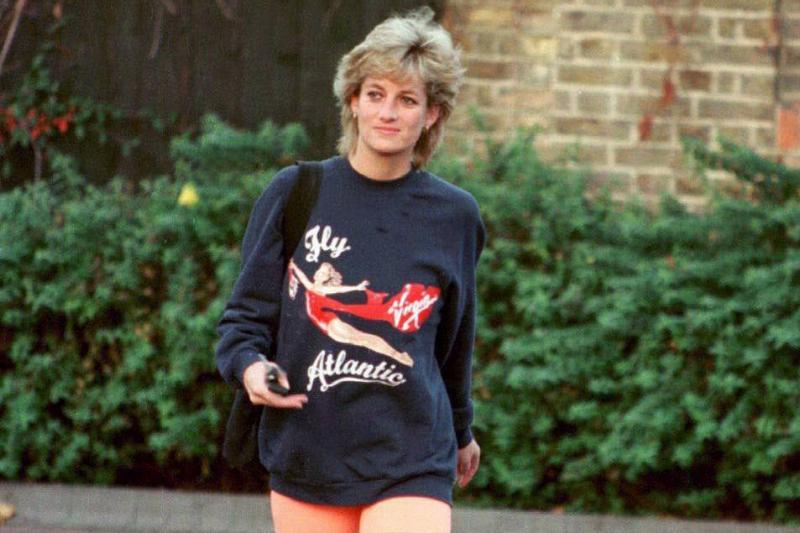 Princess Diana wears a Virginia Atlantic sweatshirt and orange shorts.