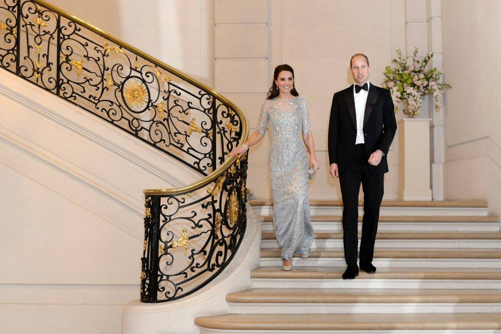 Kate and Prince William walking down stairs in Paris in 2017